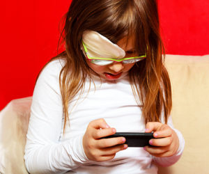 visually-impaired girl on mobile device